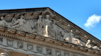 Above the entrance to the Archives.